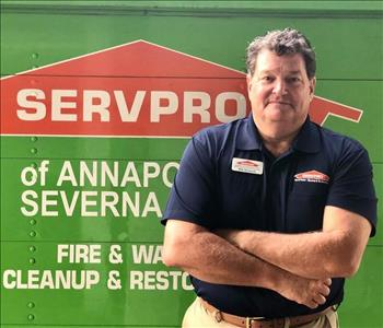Man standing in front of SERVPRO sign