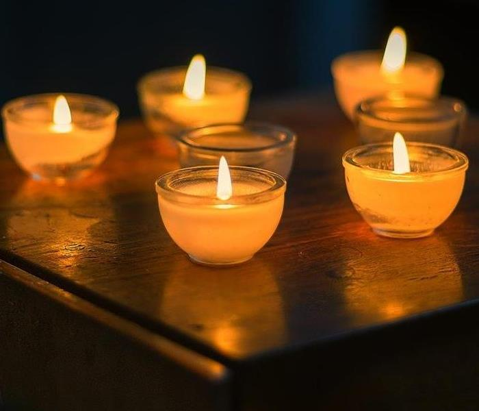 small lit candles in jars