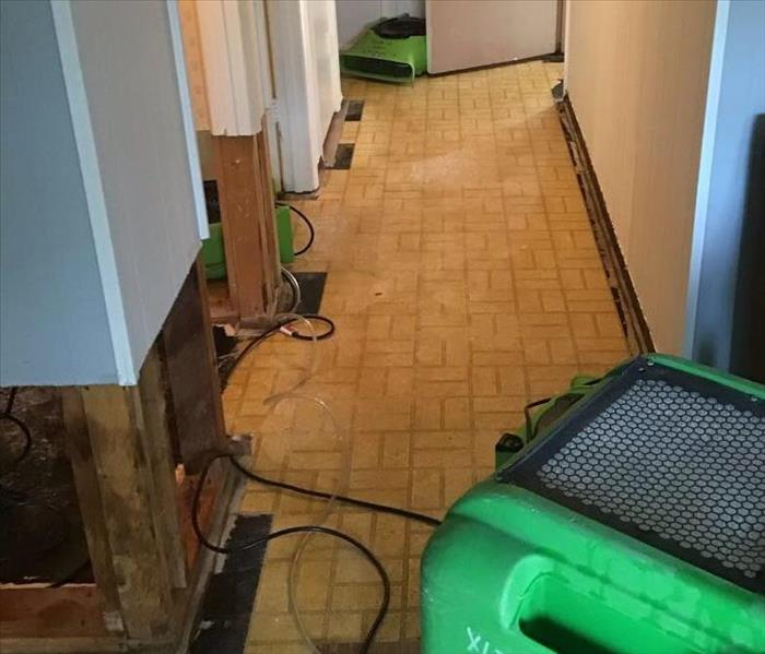 water damage in basement drywall and baseboards removed